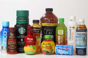 Most shrink-sleeve labels pose challenges for PET bottle recycling, but recycling-friendly innovations were recently recognized by the Association of Plastic Recyclers. | Jared Paben/Resource Recycling, Inc.
