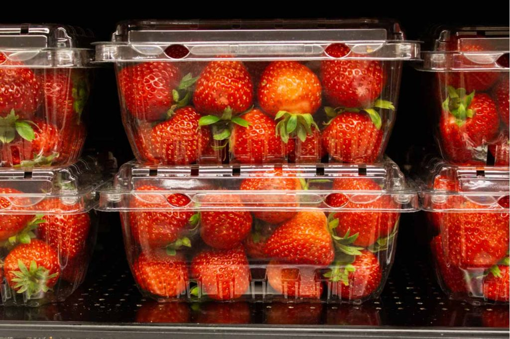 Strawberries in plastic packaging.