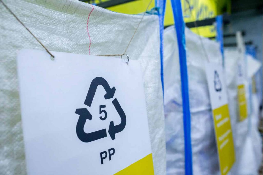 Sign for collection of #5 PP plastics for recycling.
