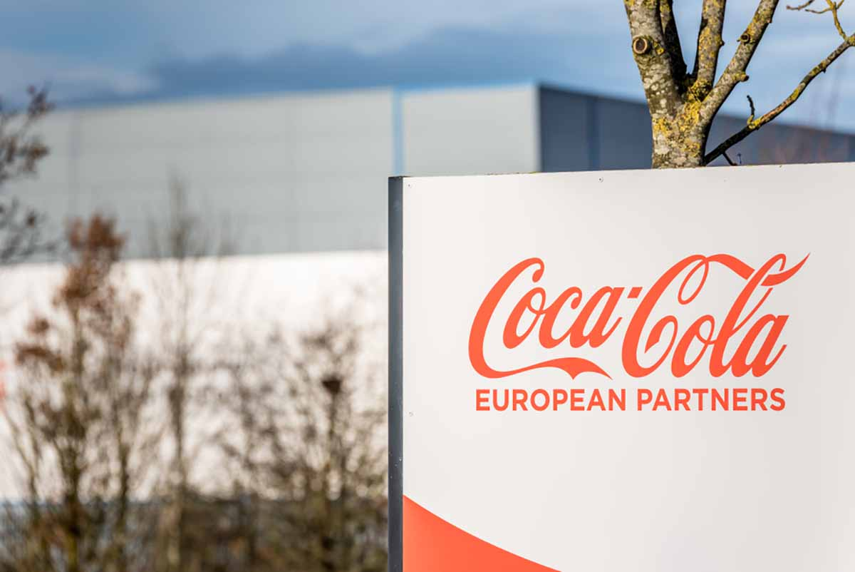 Sign in front of Coca-Cola European Partners building.