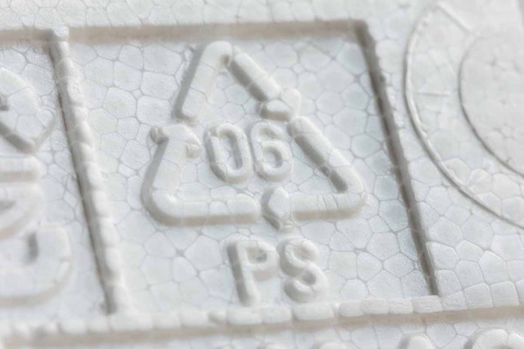 Closeup of a PS #6 recycling symbol.