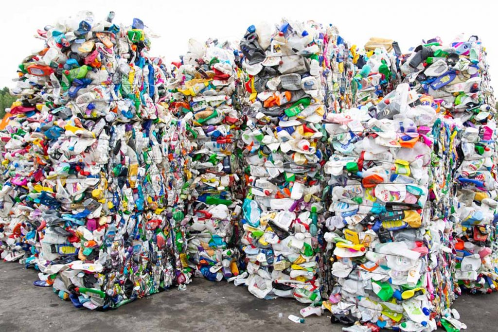 Baled plastics for recycling.