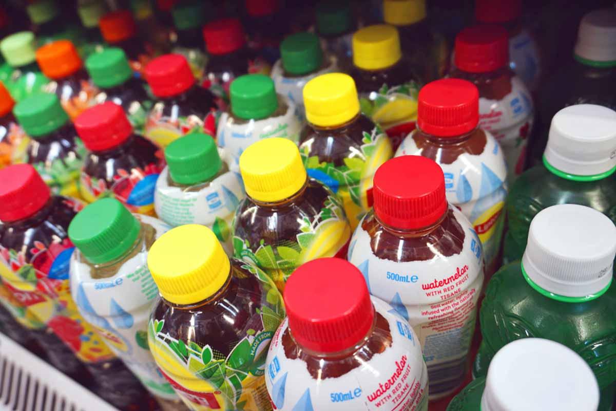 Plastic beverage bottles on a store shelf.