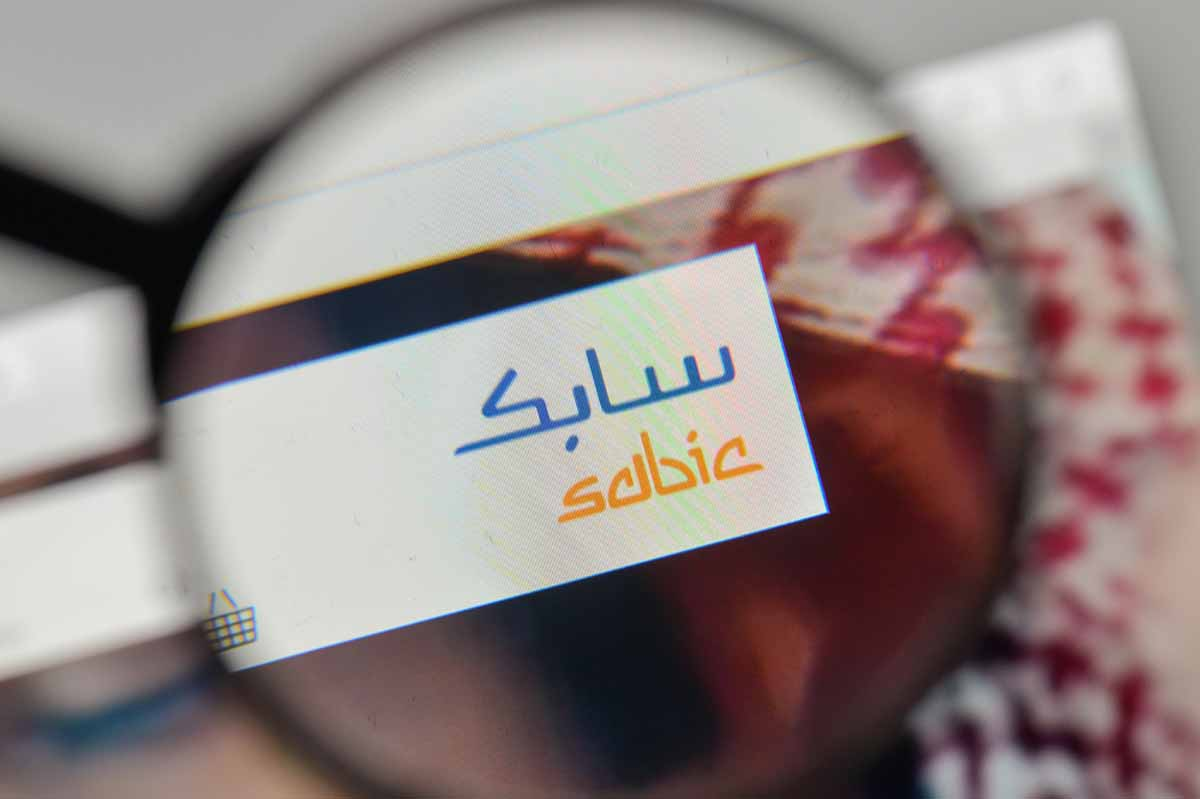 Sabic logo on website, seen through magnifying glass.