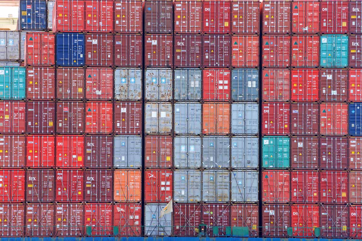 Stacked cargo containers on a ship.