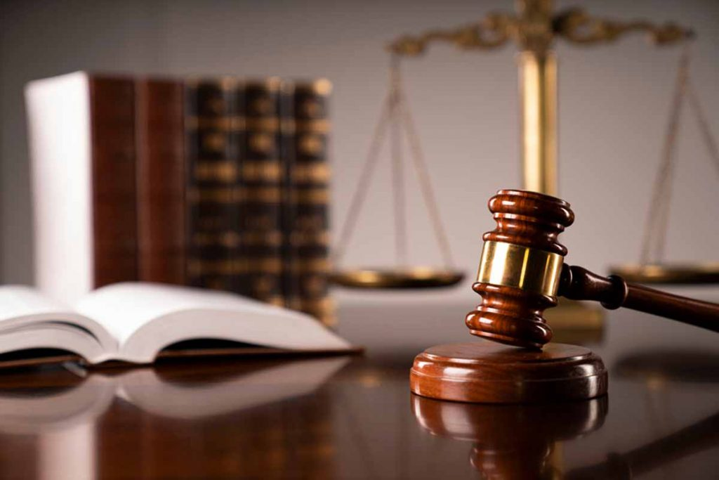 A law office scene with gavel and scales.