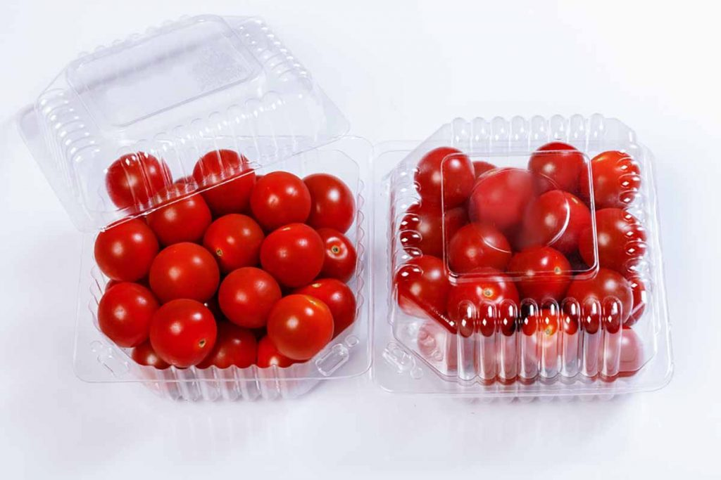 Plastic thermoform packaging containing tomatoes.