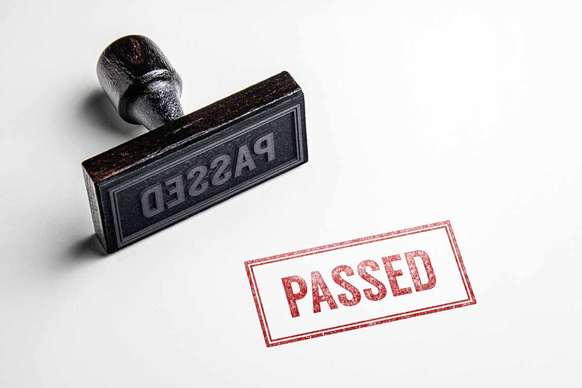 """Rubber stamp of the word """"Passed"""""""