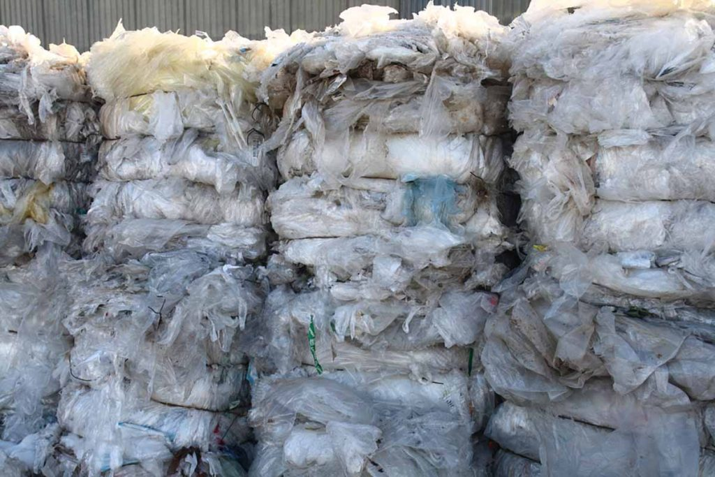 Baled plastic film for recycling.