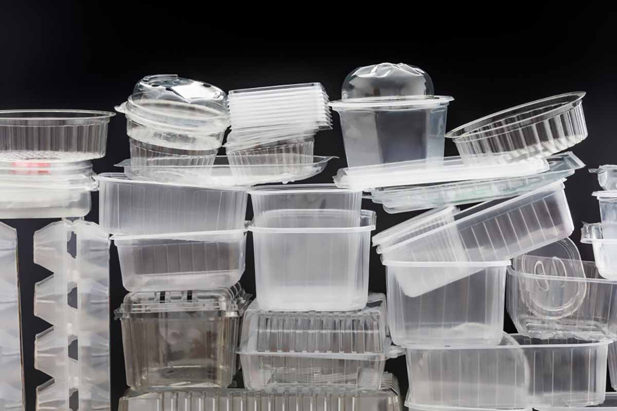 Pile of empty plastic packaging containers.
