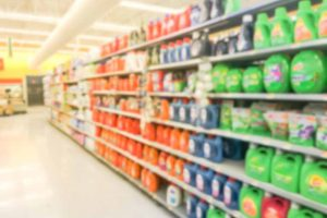 Blurred view of grocery store aisle.