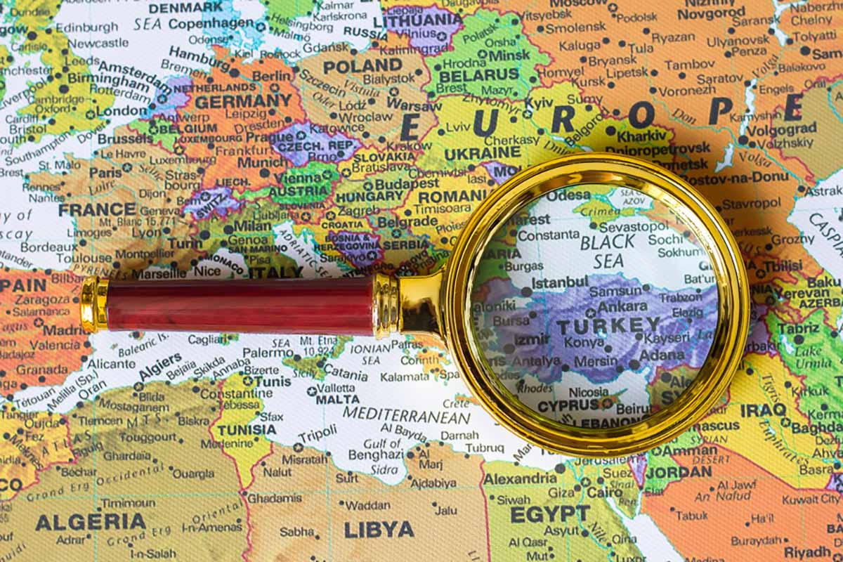 View of Turkey on a map under a magnifying glass.