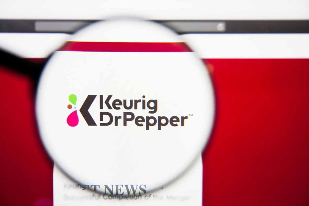 Keurig Dr Pepper logo on screen under magnifying glass