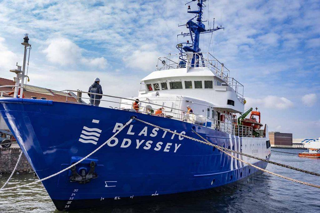 Plastic Odyssey ship at port.