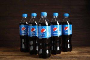 Pepsi bottles arranged on a table.