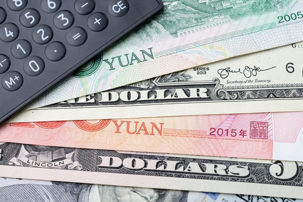 U.S. and Chinese currency with a calculator.