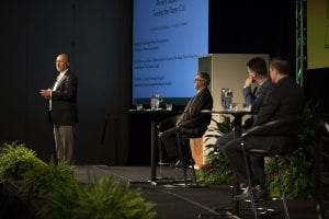 Presenters on stage at the Resource Recycling Conference.
