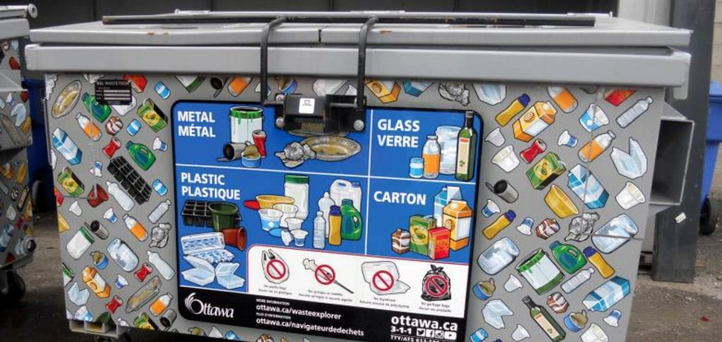 New recycling collection container with visual instructions.