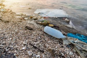 Marine debris littering an ocean beach.