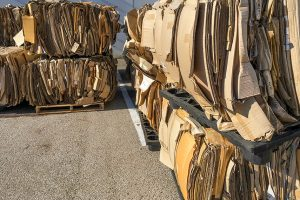 Bales of cardboard gathered for recycling.