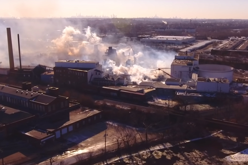 Burning paper mill from above.