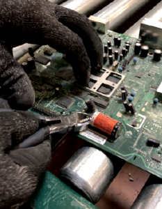 Removing a battery from a scrap device.
