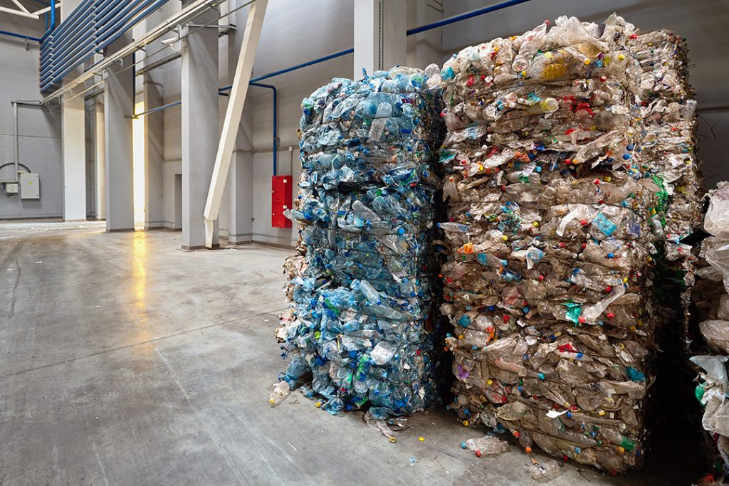 Bales of plastics in a recycling facility.