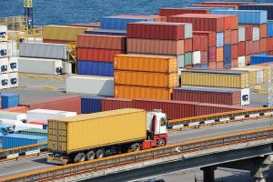 Cargo containers stacked at a logistics hub.