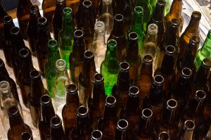 Glass bottles gathered for recycling.