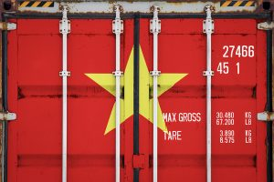 Closeup of cargo container with a Vietnam flag painted on.