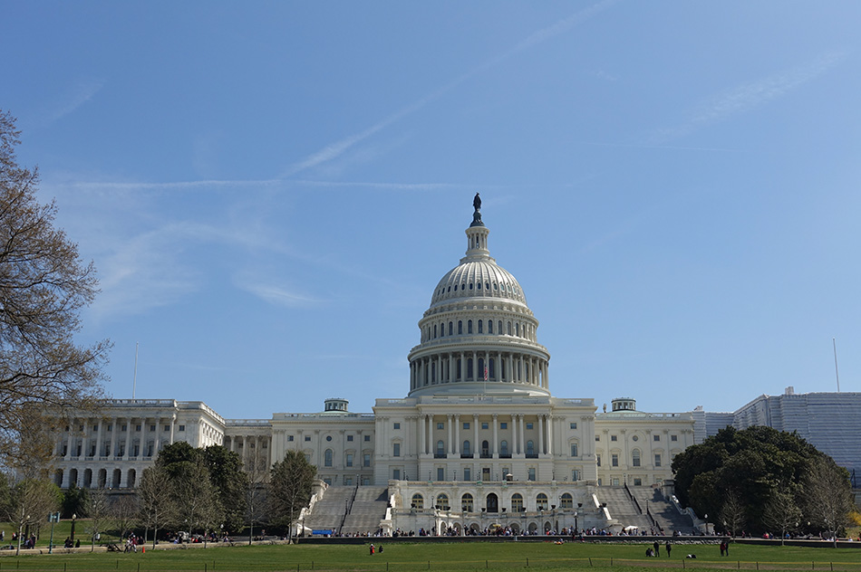 View of the U.S. Capitol building with blue sky.