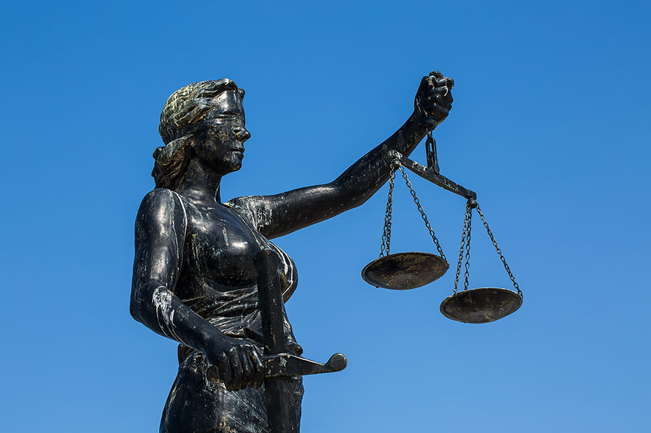 Statue of Justice with scales.