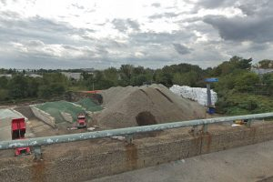 An October 2018 Google Street View image of material stored at the 1 Craven Point Ave. site, with the neighborhood generating complaints to city officials at right.