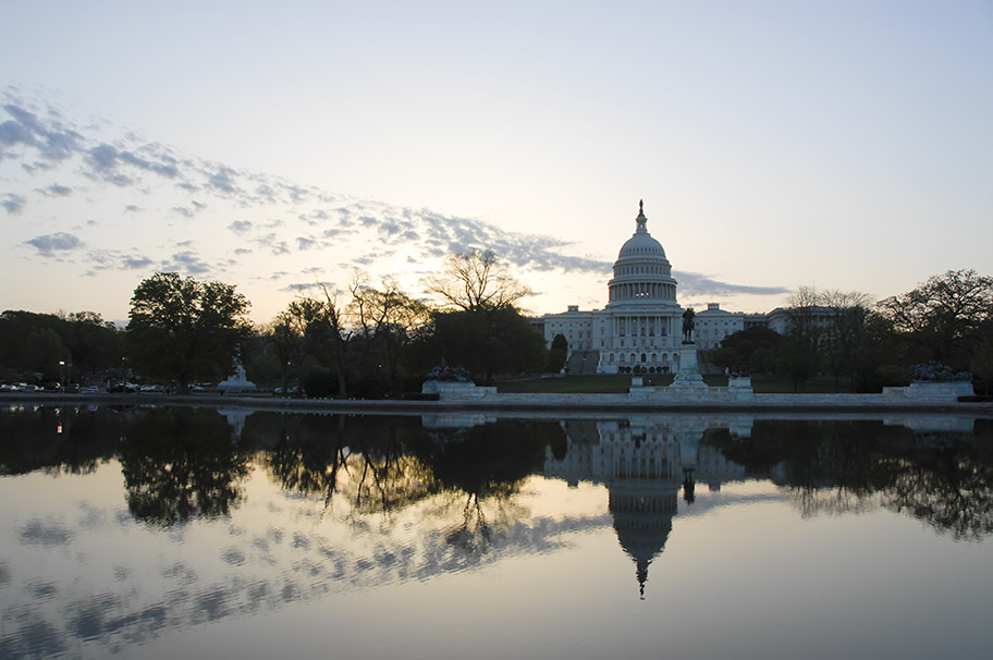 U.S. Capitol building with reflection.