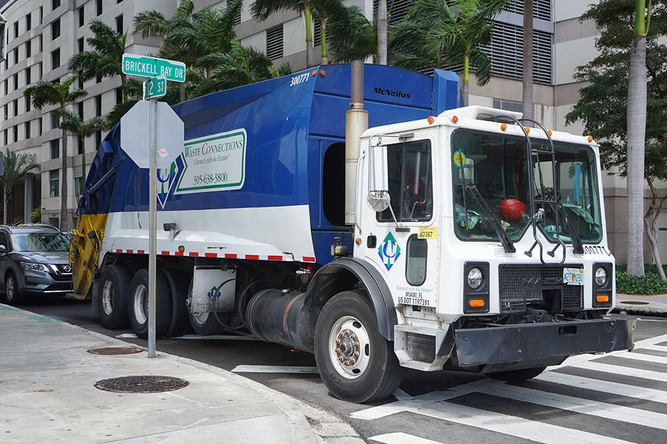 Waste Connections company truck on an urban street.