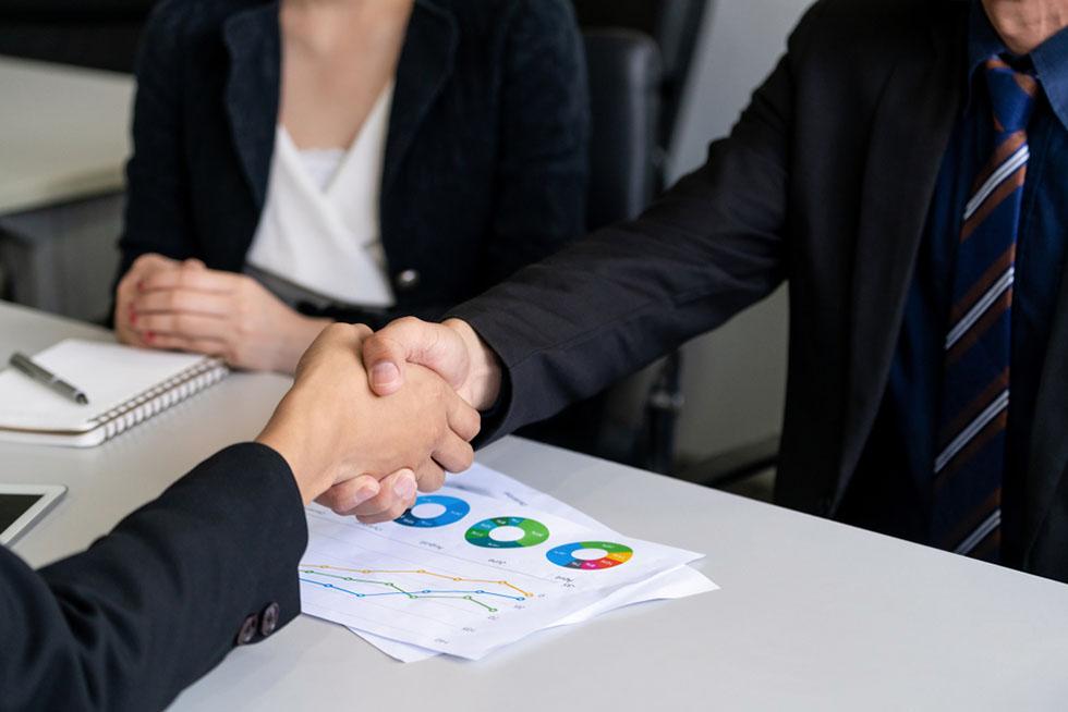 Business handshake at meeting.
