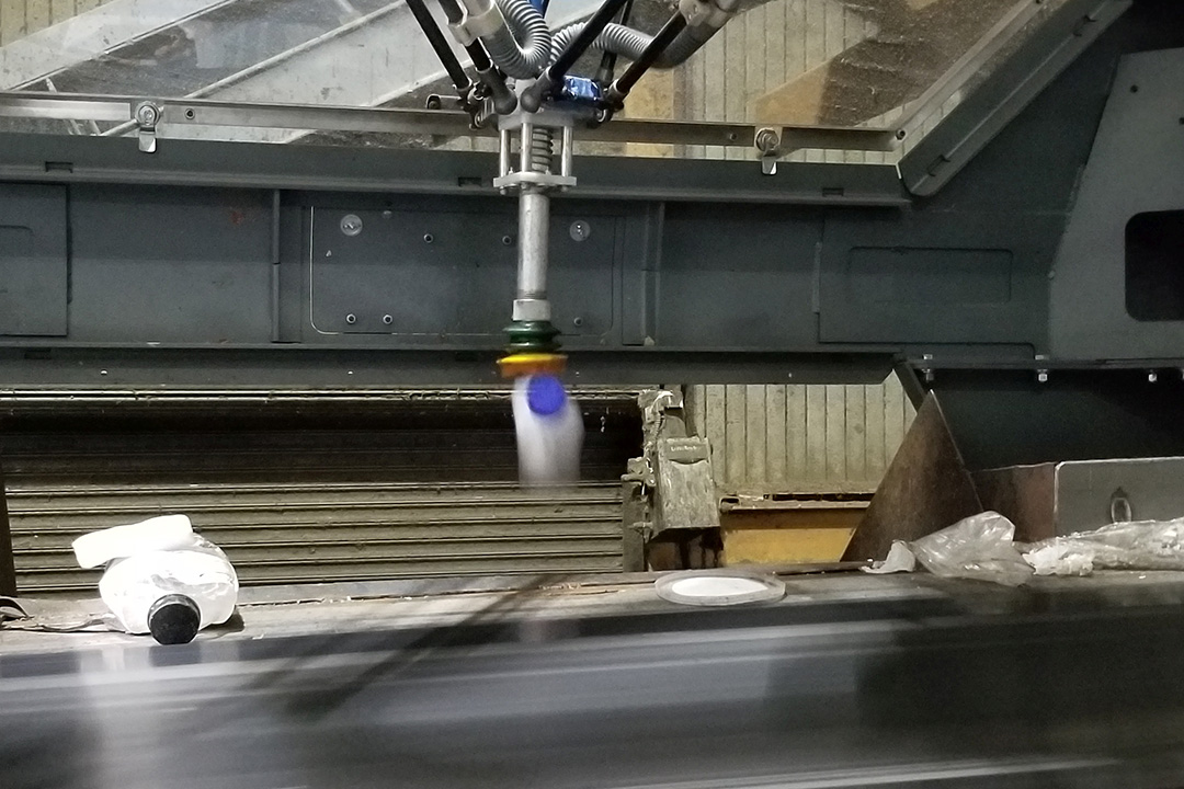 Robot sorting plastic at Recology facility.