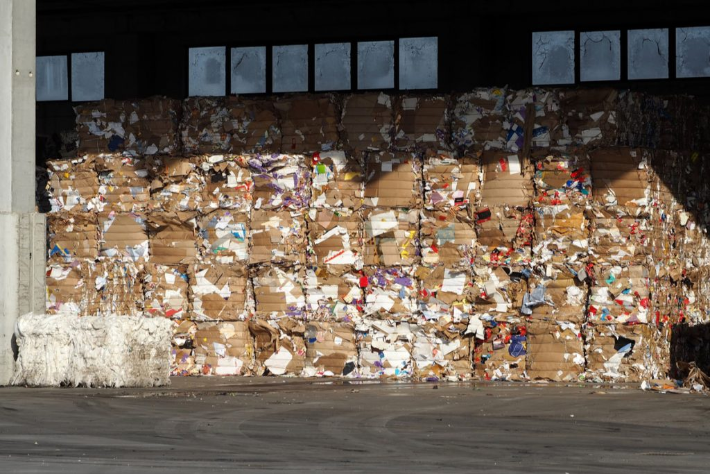 Baled fiber stacked for recycling.
