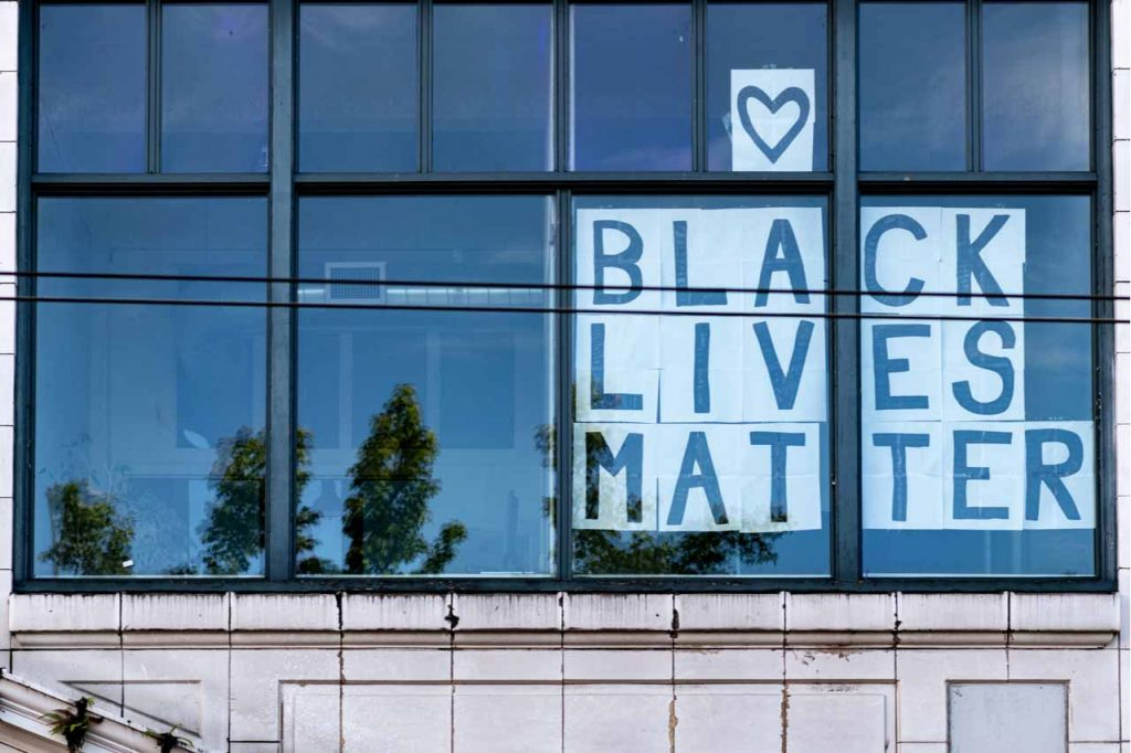 A Black Lives Matter sign in an office window.