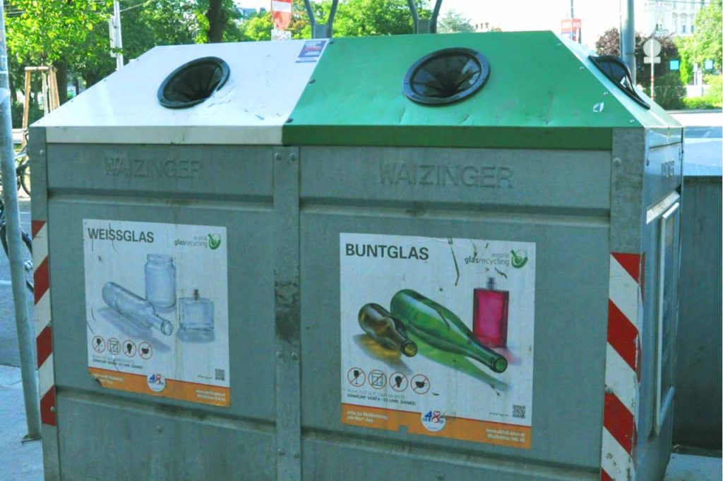 Glass recycling collection bins in Europe.