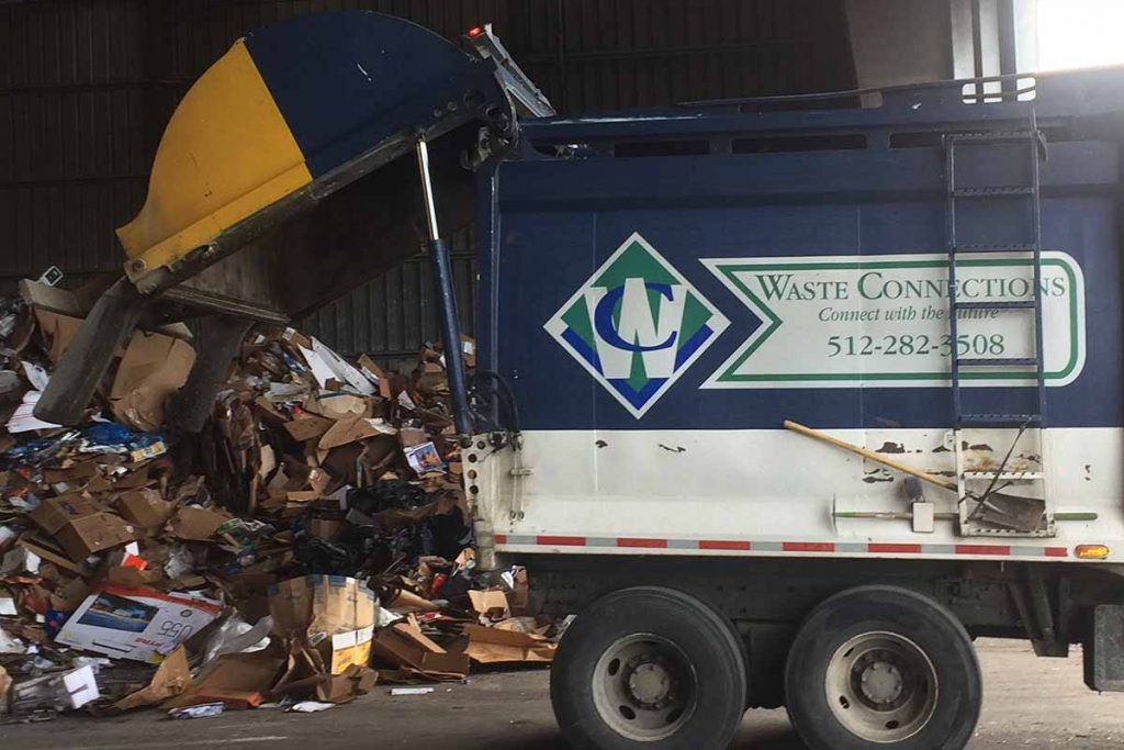 Waste Connections recycling collection truck unloads material at the Balcones MRF in Austin, Texas.