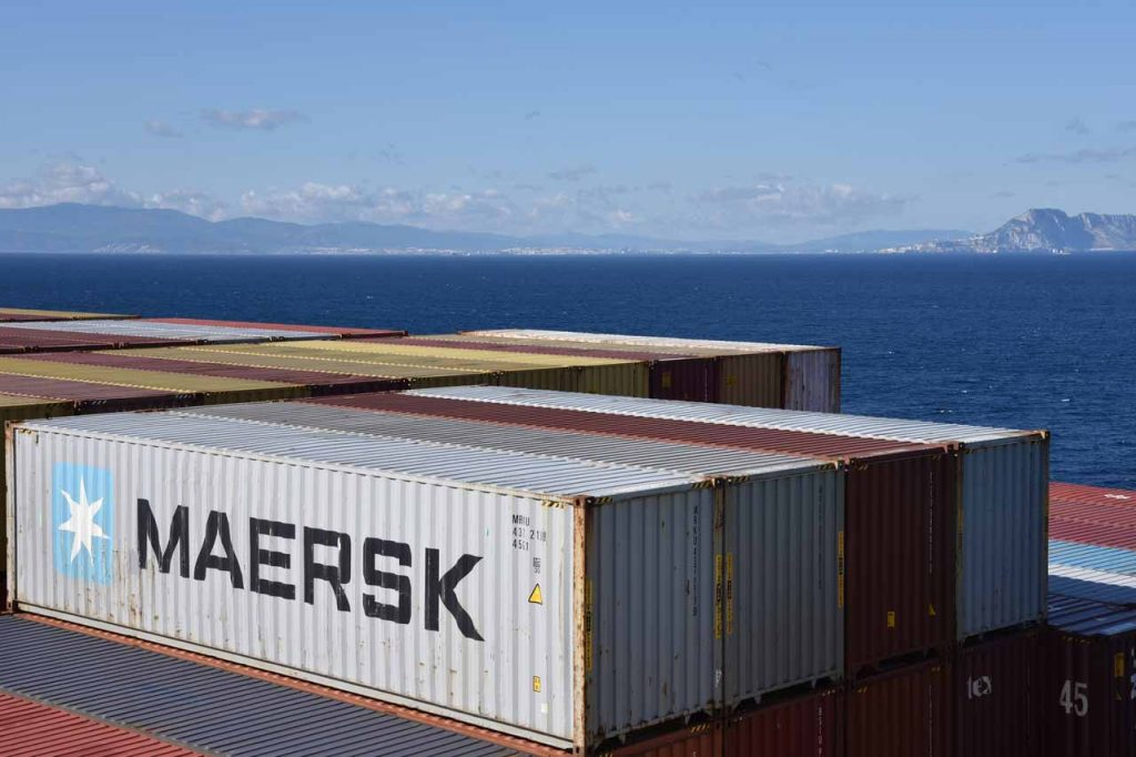 Maersk shipping container on a ship at sea.