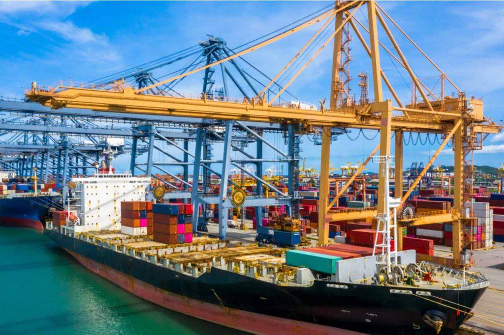 Cargo ship docked at a shipping terminal.