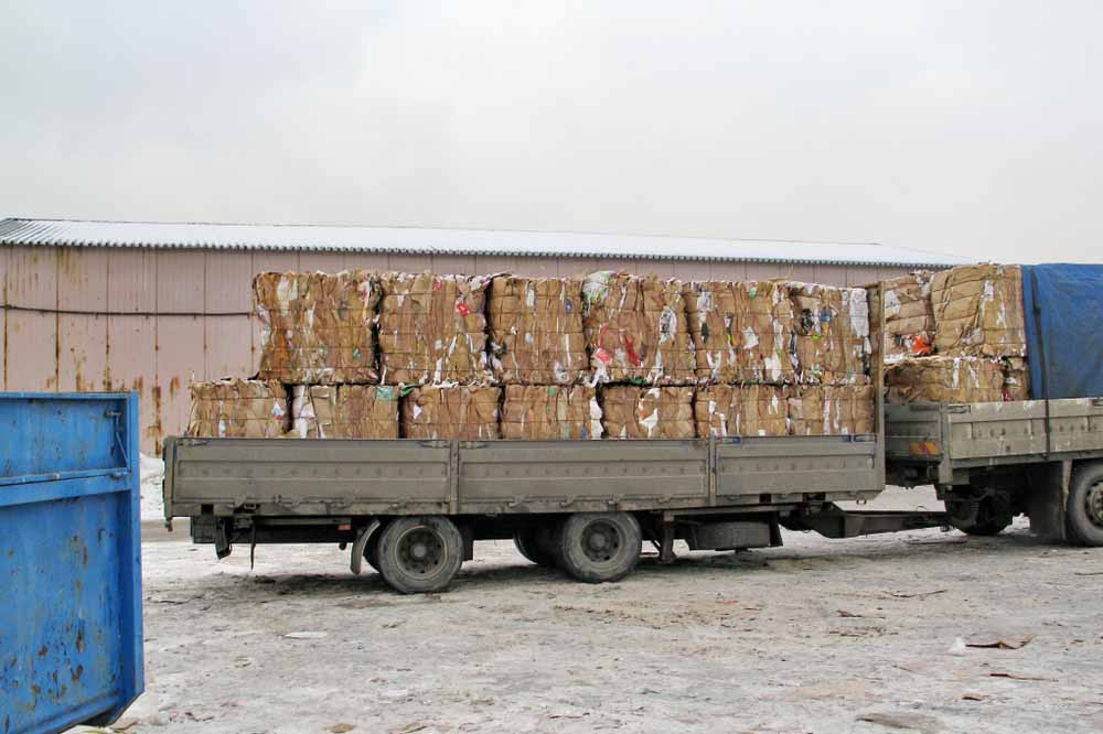 Paper bales on a truck ready for recycling.