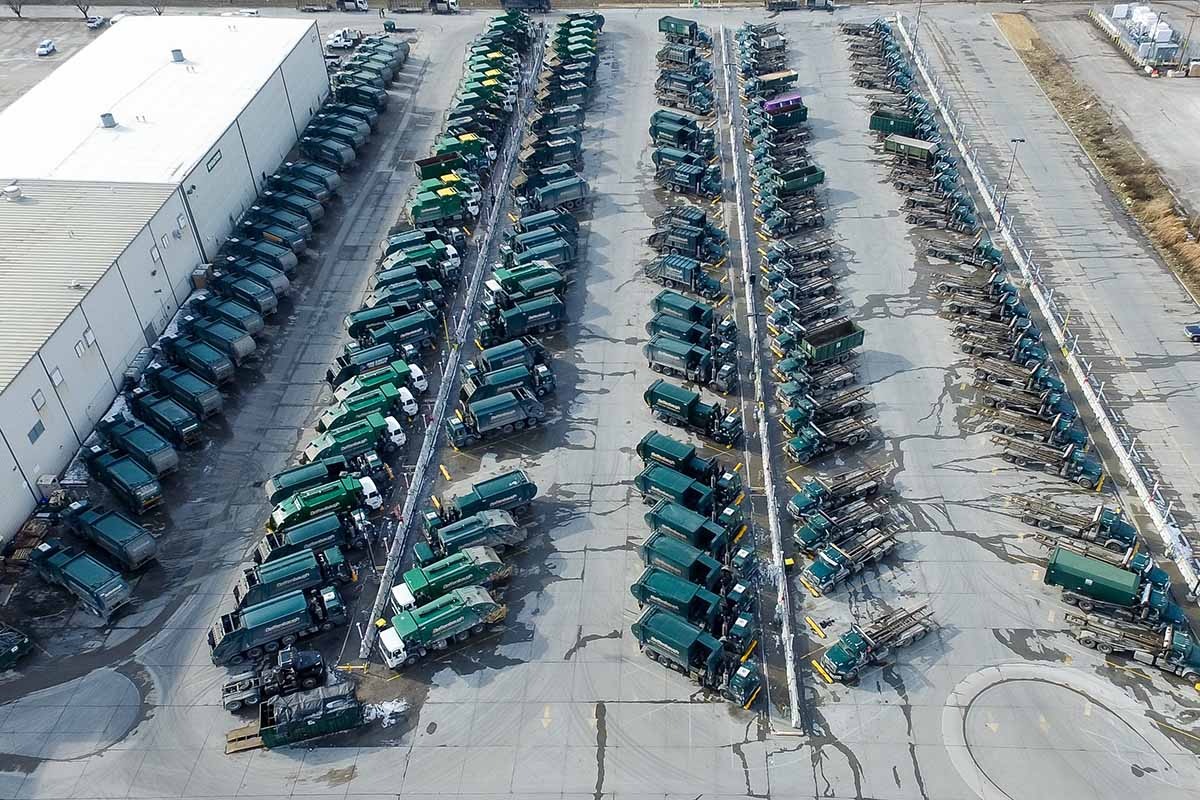Waste Management fleet of trucks from above.