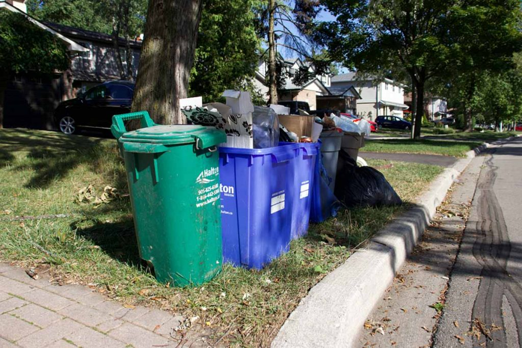 Curbside waste and recycling bins in Oakville, Ontario.