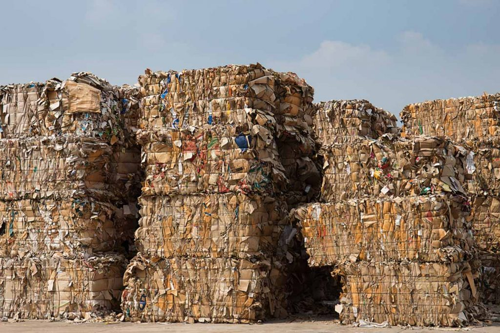 Stacks of baled paper for recycling.