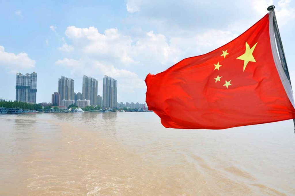 Chinese flag with the Yangtze River in background.