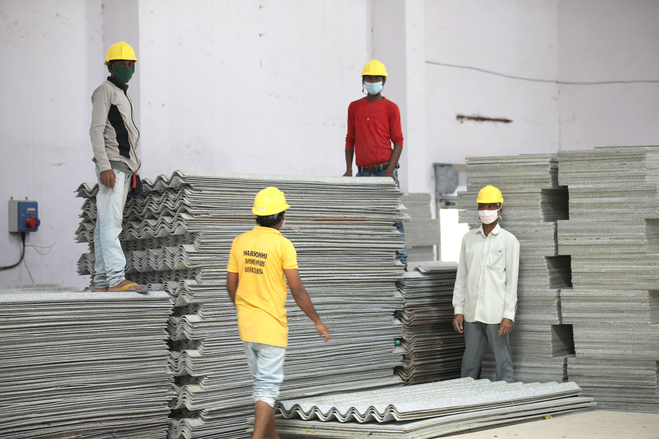 Workers at Deeya Panel Products with the recycled material panels.