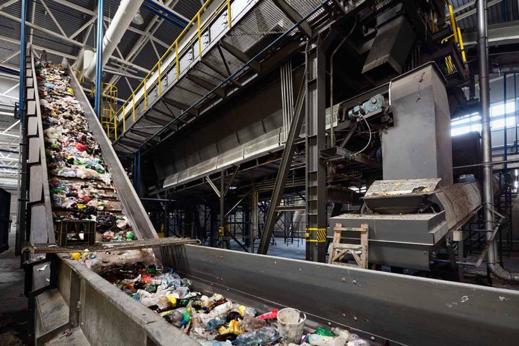 A conveyor belt carries materials inside a MRF.